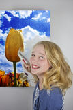 Girl painting tulip field Stock Photo