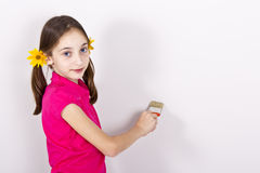 Girl painting on the wall Royalty Free Stock Photos