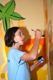Girl painting wall Stock Photography
