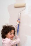 Girl painting a wall Royalty Free Stock Image