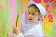 Girl painting wall Stock Images