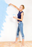 Girl painting the walls Stock Photos