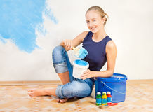 Girl painting the walls Stock Photography