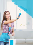 Girl painting the walls Stock Photo