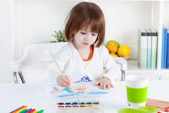 Girl painting with water colors royalty free stock photography