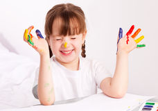 Girl painting with watercolor Stock Images