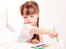 Girl painting with watercolor Stock Image