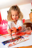 Girl is painting Stock Photo