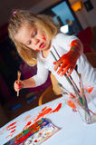 Girl is painting Royalty Free Stock Photo