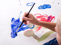 Girl painting with watercolors Stock Images