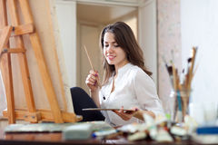 Girl paints on canvas with oil colors Royalty Free Stock Images