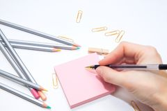 Colorer - antistress with colored pencils.Girl paints a coloring book for adults with crayons. Girl paints a coloring book for adults with crayons. colorer Stock Photos
