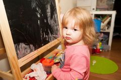 Girl paints at the easel Royalty Free Stock Photography