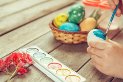 Girl paints Easter egg Royalty Free Stock Photos
