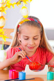 Girl paints easter eggs Royalty Free Stock Image