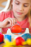 Girl paints easter eggs Stock Image