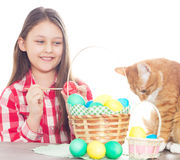 Girl paints the Easter eggs Royalty Free Stock Photography