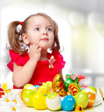 Girl paints eggs Stock Photography