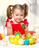 Girl paints eggs Royalty Free Stock Photo
