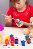 Girl paints eggs Royalty Free Stock Images