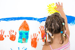 Girl paints with finger paints Stock Photo