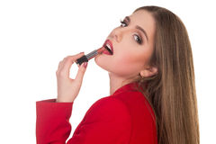 Girl paints her lips red lipstick Stock Photos