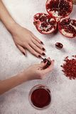 Girl paints her nails the gel Polish. White background royalty free stock image