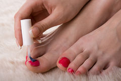 Girl paints her nails Stock Photos