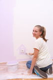 Girl paints house in lilac color Stock Photography