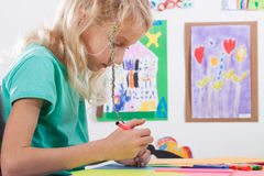 Girl paints markers for art lessons Stock Photos