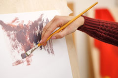 Girl paints in oils Royalty Free Stock Photography
