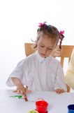 Girl paints Royalty Free Stock Photos