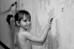 Girl paints the wall Stock Photo