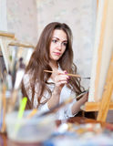 Girl paints in workshop Royalty Free Stock Images