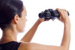 A girl and a pair of binoculars Stock Images