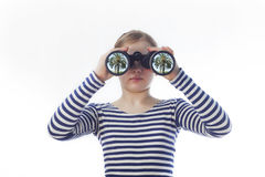 girl and a pair of binoculars Royalty Free Stock Photos