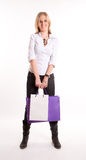 Girl with a pair of shopping bags Stock Images