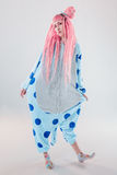 Girl in pajamas. Funny girl in blue pajamas on white background Stock Photography