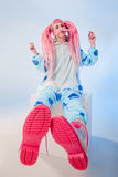 Girl in pajamas. Funny girl in blue pajamas on white background Royalty Free Stock Photography