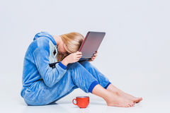 Girl in pajamas with a laptop Royalty Free Stock Photography