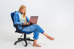 Girl in pajamas with a laptop Stock Photo