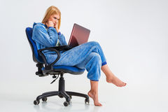 Girl in pajamas with a laptop Royalty Free Stock Images