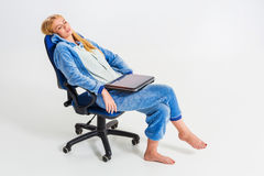 Girl in pajamas with a laptop Stock Image