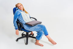 Girl in pajamas with a laptop Royalty Free Stock Photos