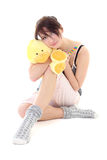 Girl in pajamas with toy and lollipop Stock Photos