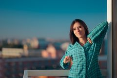 Girl in pajamas waking up early and stretching in morning light Royalty Free Stock Photo
