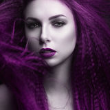 The girl with pale skin and purple hair in the form of a vampire. Insta color. Royalty Free Stock Images