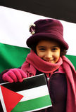 Girl with palestinian flag. A little beautiful girl holding palestinian flag in front on another one Royalty Free Stock Photo