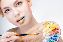 Girl with palette Stock Image
