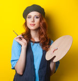 Girl with palette and brush Stock Photos
